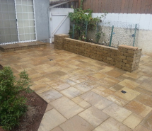 Patio with westone seating wall step
